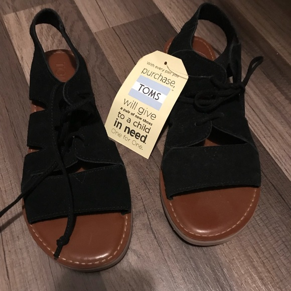 57d04aba3d37 Women s toms sandals black and brown leather. NWT